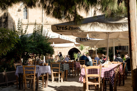 selimiye mosque: NICOSIA, CYPRUS - DECEMBER 03, 2015: People sitting at outdoor restaurant near Selimiye mosque (ex. St. Sophia Cathedral).