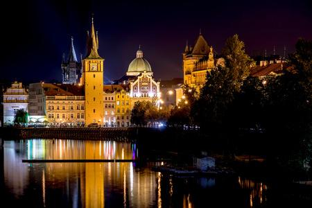 Scenic night view of Charles Bridge and buildings along the Vltava river. Prague, Czech Republic. Stock Photo