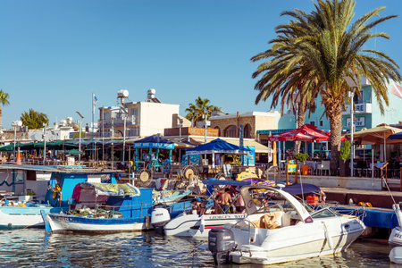 moorings: LATCHI, CYPRUS - JULY 24, 2016: Harbour Waterfornt and Restaurants.