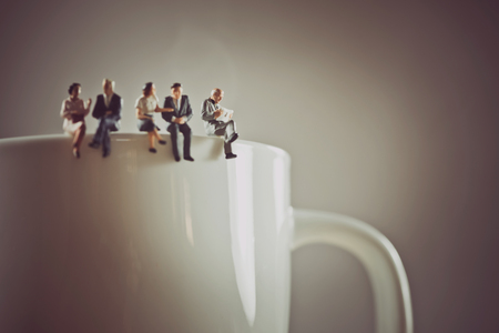 Office workers having a coffee break.