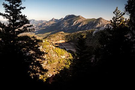 st hilarion: Kyrenia Mountain Range and road to St Hilarion Castle. Kyrenia District, Cyprus. Stock Photo
