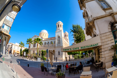 LIMASSOL, CYPRUS - MARCH 18, 2016: Street cafe terrace in old town of Limassol City.