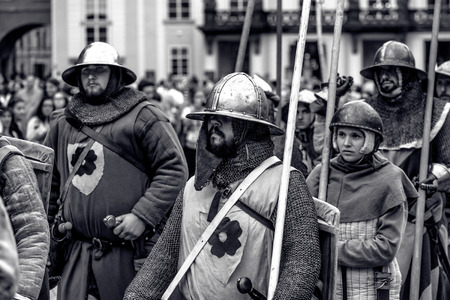 PRAGUE, CZECH REPUBLIC - SEPTEMBER 04, 2016: Armored knights lead the march of Charles IV at re-enactment of the Coronation of Charles IV in Prague Castle.
