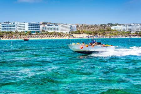 AYIA NAPA, CYPRUS - JULY 16, 2016: Speedboat cruising in Mediterranean sea along the coast near Ayia Napa.