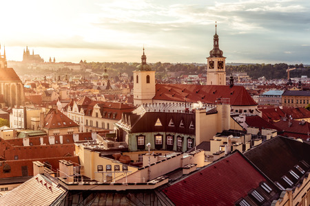 The Basilica of St James and Prague cityscape. Czech Republic.