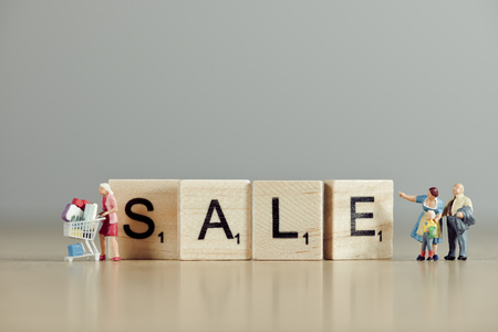 Word sale spelled out with wooden tiles.