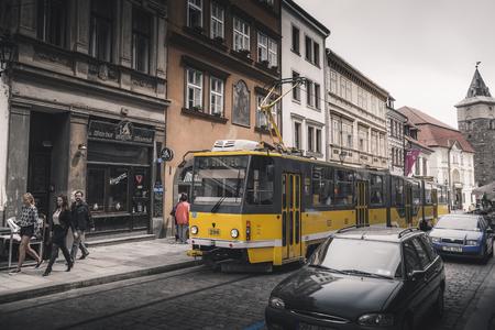 PILSEN (PLZEN), CZECH REPUBLIC - MAY 22, 2017: Yellow tram in Lisbonwery on the street of Pilsen