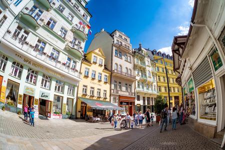 KARLOVY VARY, CZECH REPUBLIC - MAY 26, 2017: Tourist group walking along Lazenska pedestrian street.