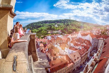 PRAGUE, CZECH REPUBLIC - MAY 25, 2017: Family of Tourists overlooking Prague. Editorial