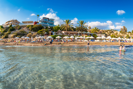 People relaxing on Coral Bay Beach, one of the most famous beaches in Cyprus. Editoriali