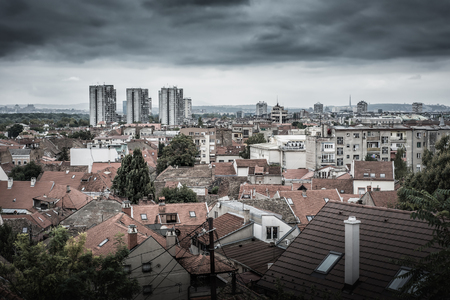View of the old Zemun quarter with modern buildings on the background. Belgrade, Serbia.