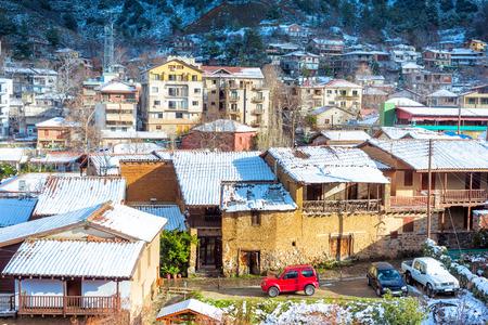 Beautiful winter landscape with snow covered Kakopetria village. Cyprus. Standard-Bild