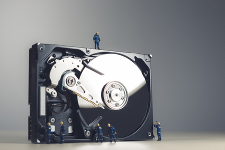 Maintenance and repairing of HDD. Technology concept. Stock Photo