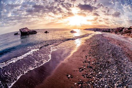 Seascape sunset near Petra tou Romiou. Paphos District, Cyprus. Stock Photo