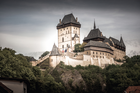 View of Karlstein Castle, a large Gothic castle founded in 1348 by King Charles IV. Karlstein village, Central Bohemia, Czech Republic. Editorial