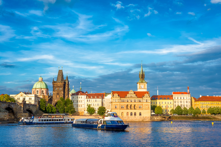 Sightseeing cruise boat on Vltava river with Charles Bridge on background. Prague, Czech Republic. Stock Photo