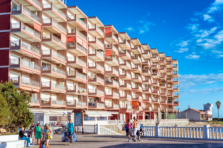 TORREVIEJA , SPAIN - NOVEMBER 13, 2017: Promenade along Playa De Los Locos beach.