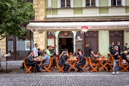 PRAGUE, CZECH REPUBLIC - MAY 25, 2017: People have a lunch on Ovocny square in the Old Town of Prague. Editorial