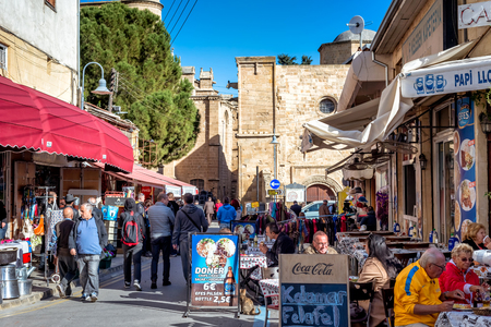 NICOSIA, CYPRUS - DECEMBER 03, 2015: Cafes and restaurants at Arasta street, a touristic street leading to an Selimiye mosque.