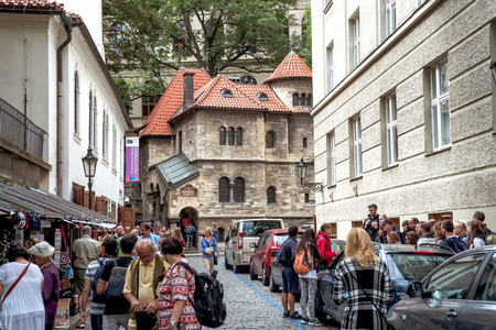 PRAGUE, CZECH REPUBLIC - SEPTEMBER 05, 2016: People are visiting Klausen Synagogue which is the largest synagogue in the former Prague Jewish ghetto.