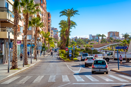 TORREVIEJA , SPAIN - NOVEMBER 10, 2017: Paseo Vistalegre, a busy road with shops and traffic in the downtown area of the city.