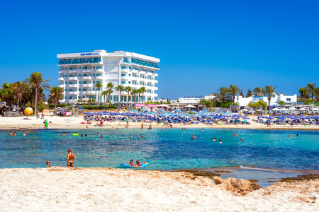 AYIA NAPA, CYPRUS - AUGUST 18, 2016: People enjoying nice summer day in Vathia Gonia (Sandy bay) Beach. Editorial