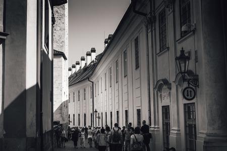 PRAGUE, CZECH REPUBLIC - SEPTEMBER 07, 2016: Group of tourist at Jirska street opposite to St. Georges Basilica, a part of Prague Castle.
