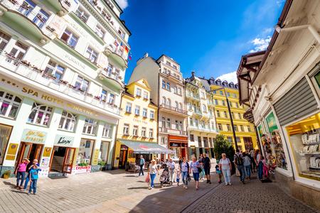 KARLOVY VARY, CZECH REPUBLIC - MAY 26, 2017: Groups of Tourist walking along Lazenska pedestrian street.