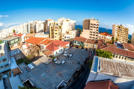Residential buildings above the roofs of Old Town. Limassol, Cyprus Stock Photo