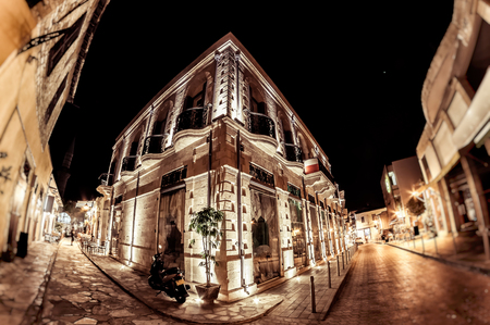 Old colonial style building at Agiou Andreou street at night. Limassol, Cyprus