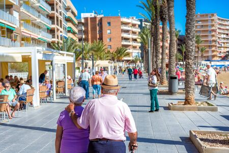 TORREVIEJA, SPAIN - NOVEMBER 13, 2017: A senior couple walking on the streets of Torrevieja.
