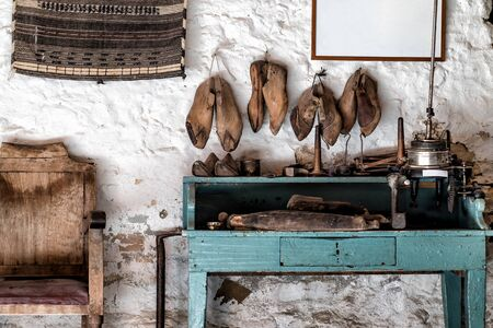 Vintage shoemaker workshop with shoes molds