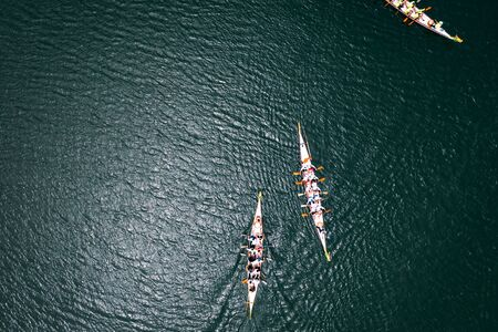 Overhead view of Dragon boat races on a lake Standard-Bild