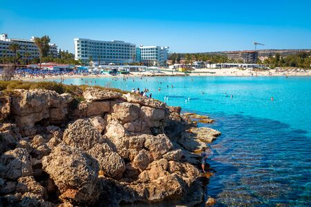 Coastline at Nissi Beach, view from a rocky islet. Ayia Napa, Famagusta District, Cyprus Archivio Fotografico