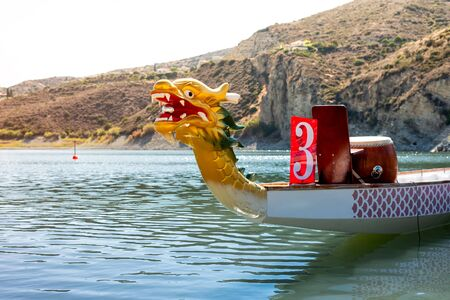 A brightly coloured Dragon Boat on the river