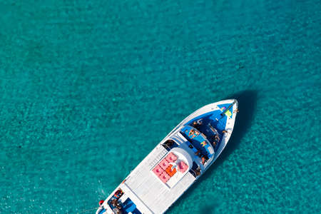 Top view of a yacht in clear blue sea