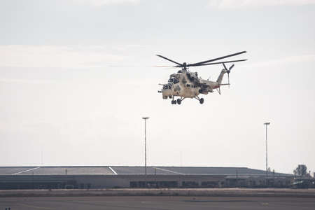 Attack helicopter leaving air force base Standard-Bild