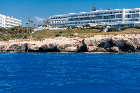 View of stone cliffs and hotels at Ayia Napa coastline . Famagusta district, Cyprus