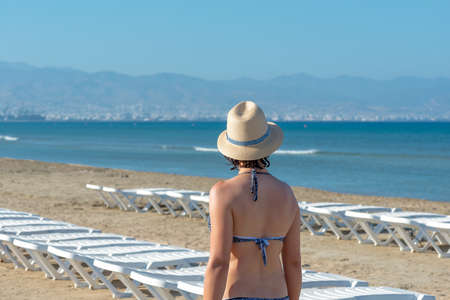 Woman at Lady's mile beach. Limassol District, Cyprus