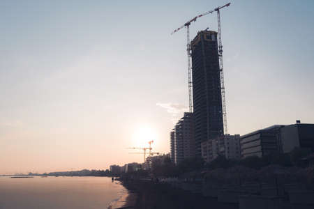 Beach in Limassol with high-rise building construction site