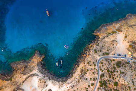 Serene sea bay with fishing boats, top view Standard-Bild
