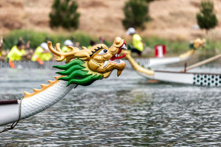 Dragon boats racing. Decorated head of the boat.