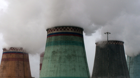 steam coming out of the cooling towers of thermal power plants