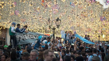 MOSCOW, RUSSIA - June 15, 2018: Argentine fans sing songs on the nikolskaya street in Moscow Editöryel
