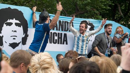 MOSCOW, RUSSIA - June 22, 2018: Argentine fans sing songs on the nikolskaya street in Moscow