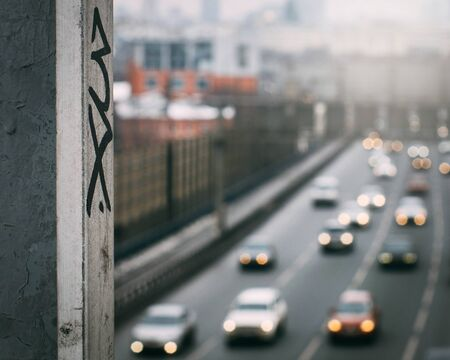 urban graffiti on the background of blurred car traffic in the background