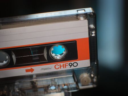 compact white orange cassette closeup. Stok Fotoğraf