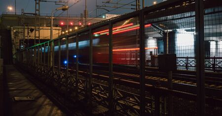 lights of the past train behind the trellis at night