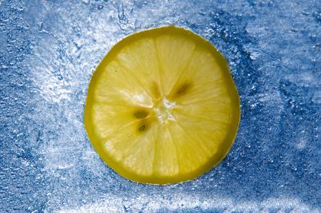 a slice of lemon on ice photo