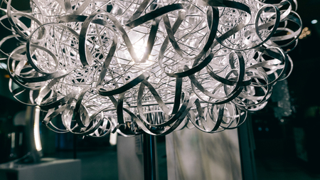 modern designer chandelier. Modern design and lighting design of the room. Design of light and space. Unfocused & fil, texture